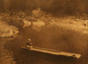 Yurok man paddling traditional redwood canoe. Photo credit: http://www.firstpeople.us/canoe/yurok-in-the-shadow.html