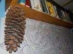 Moldy sugar pine cone hanging from my bookshelf.